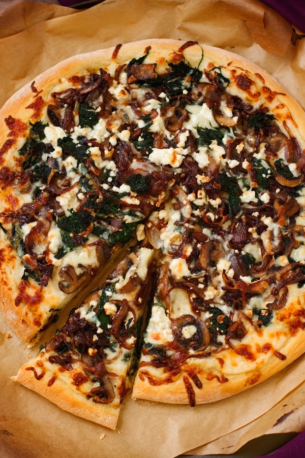 Caramelized Onion Feta Spinach Pizza with creamy white sauce! This pizza tastes like you ordered it at a fancy restaurant But it's simple to make at home! #pizza #caramelizedonions #spinachpizza #greekpizza   Littlespicejar.com @Littlespicejar