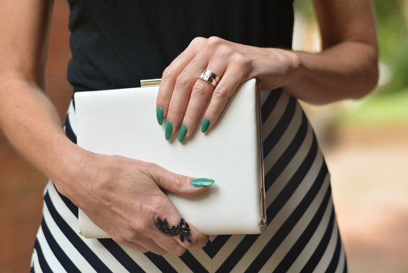 Black and white striped maxi skirt, white box clutch, emerald green mani
