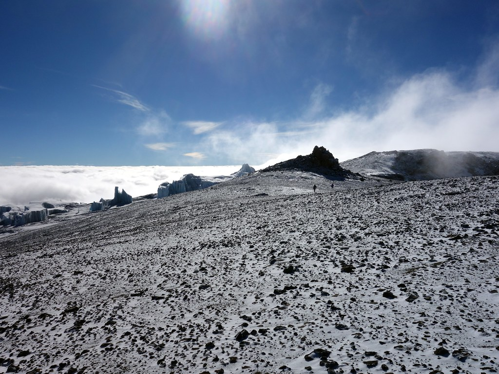 Figures on the inner crater rim, with clouds billowing up below