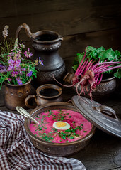 Russian cold soup with beetroot on dark wooden tab…