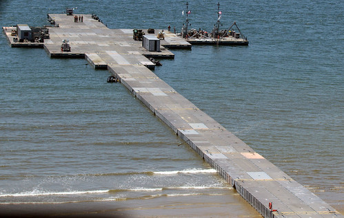 Anmyeon Beach, Republic of Korea - United States and Republic of Korea forces successfully inserted a temporary 560 meter (1,840 foot) Trident Pier into Anmyeon Beach on the west coast of the Republic of Korea June 29 as part of the Combined Joint Logistics Over-the-Shore 2015 exercise.
