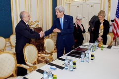 U.S. Secretary of State John Kerry shakes hands with Dr. Ali Akbar Salehi, the Vice President of Iran for Atomic Energy and President of the Atomic Energy Organization of Iran, on June 30, 2015, in Vienna, Austria, as the two see each other for the first time after their respective hospitalizations, amid negotiations about the future of Iran's nuclear program. [State Department photo/ Public Domain]