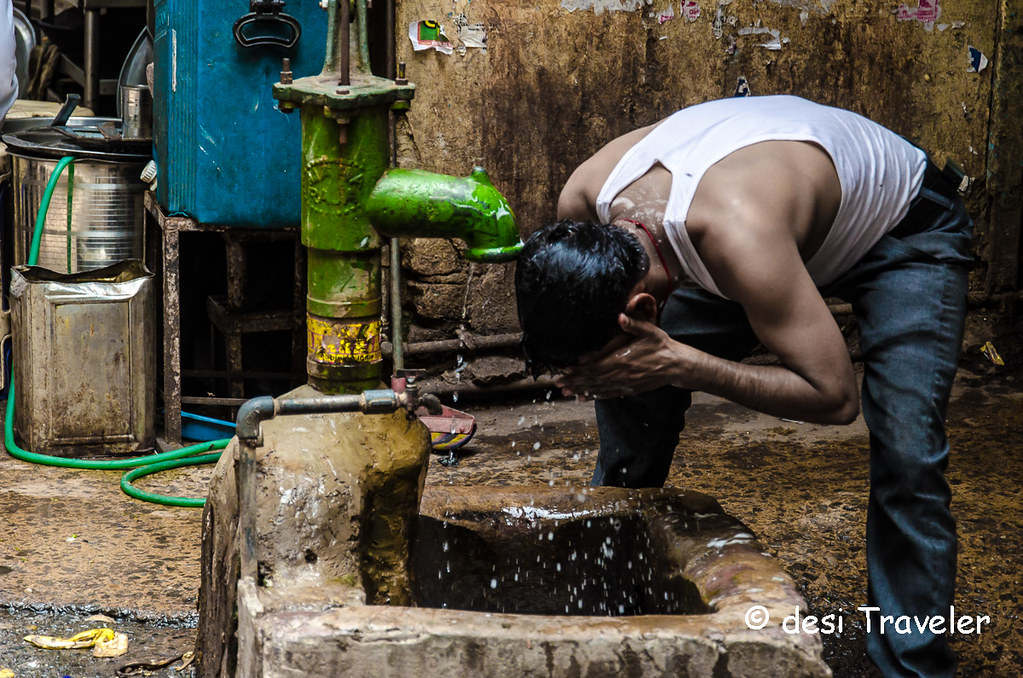 Man washing face with handpump water  Nat Geo Instawalk