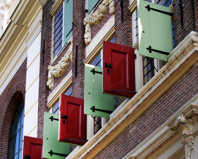 Colourful shutters adorn a building in Edam, Holland