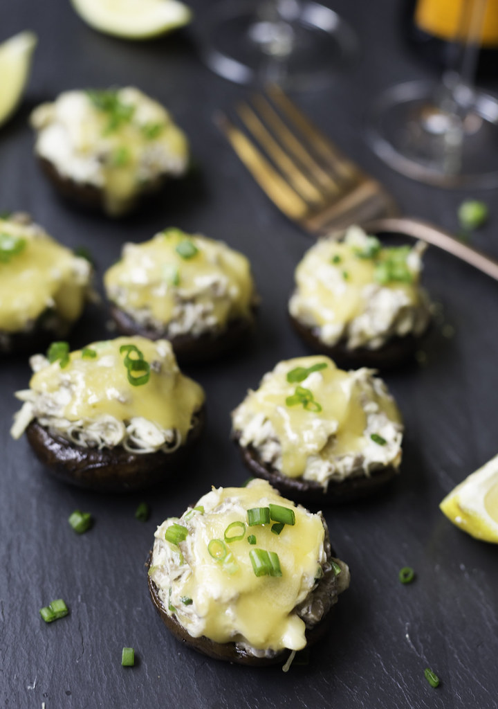 Crab and gouda stuffed mushrooms on platter
