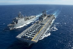 USS Bonhomme Richard (LHD 6) and USS Ashland (LSD 48) maneuver to conduct a replenishment at sea, June 5.  (U.S. Navy/MC1 Ty C. Connors)