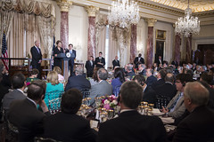 With Vice President Joe Biden and Deputy Secretary of State Antony 'Tony' Blinken looking on, Brazilian President Dilma Rousseff raises a toast to the U.S.-Brazil partnership at a State Luncheon in the Brazilian President's honor, at the U.S. Department of State in Washington, D.C., on June 30, 2015. [State Department photo/ Public Domain]