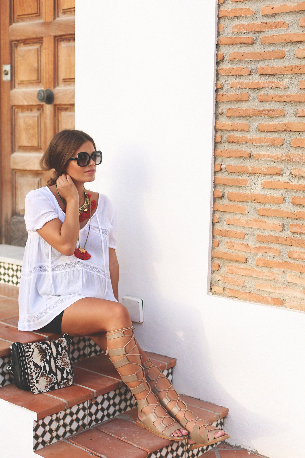 10. white loose top black tube skirt gladiator sandals - jessie chanes - pregnancy