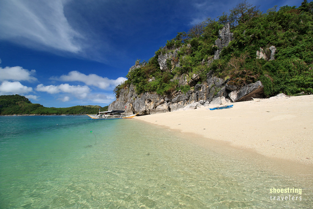 white sand and karst formations at Antonia Beach