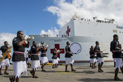 The Fiji Police Band welcomes USNS Mercy (T-AH 19) with a musical performance upon the ship's arrival in Suva, June 7. (U.S. Air Force/Senior Airman Peter Reft)