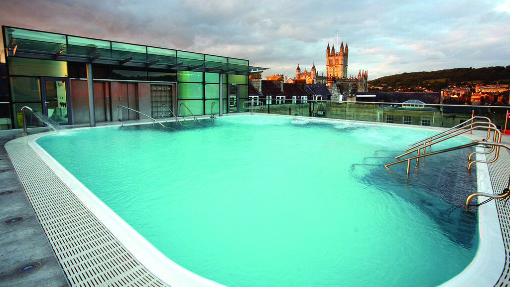 The Thermae Bath Spa rooftop pool, with Bath Abbey in the distance