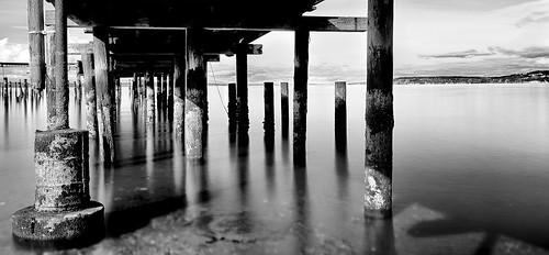 meadowdalebeachpark landscape pilings wharf blackandwhite pugetsound slowshutterspeed longexposure pier haineswharf
