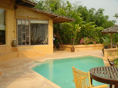 backyard, swimming pool, property, eco hotel, cottage, resort, real estate, villa, home,