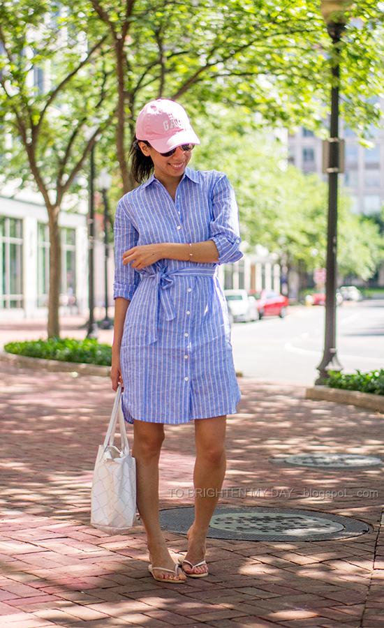 pink cap, pink and blue stripe shirtdress, white tote bag