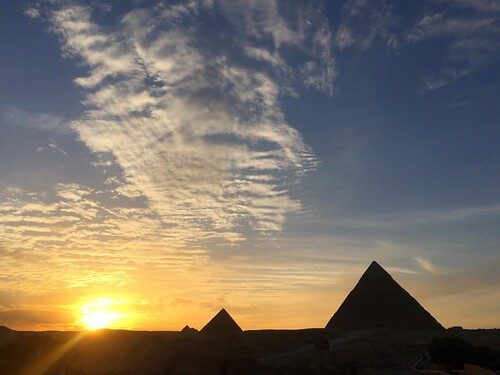 iphone6 iphonephotography white clouds yellowcolor orangecolor sunbeams sunset giza egypt ancientcivilization gizapyramids pyramids