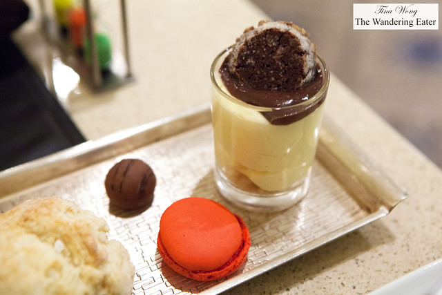 Vanilla pudding with fudge and chocolate shortbread, strawberry macaron and chocolate banana rum truffle