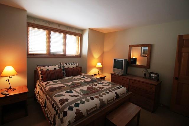 master bedroom with queen bed;
