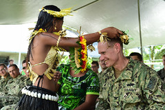 An I-Kiribati girl presents a traditional garland to Capt. James Meyer, commander of Task Force Forager and Pacific Partnership deputy mission commander, during a ribbon cutting ceremony marking the completion of renovations at Temwanoku Primary School by U.S. Navy Seabees. (U.S. Navy/MCC Jonathan Kulp)