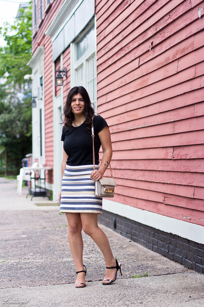 striped mini skirt, black tee, studded bag.jpg