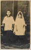 Two children dressed for First Communion