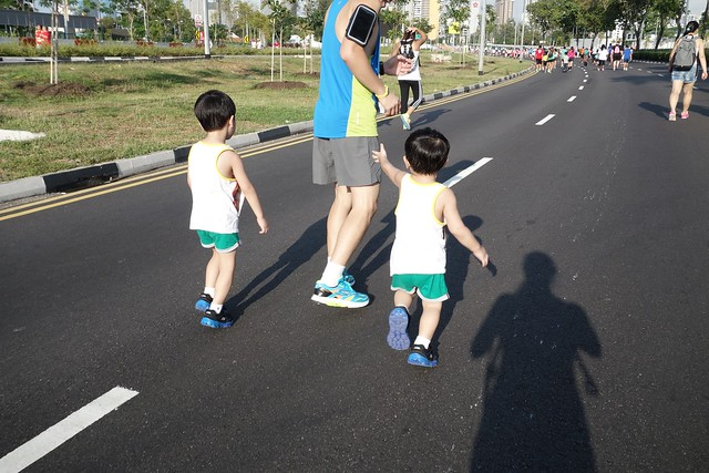 Daddy and the boys running.