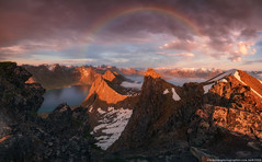 Norway. The island of Senja. Rainbow over a fjord Steinfjorden