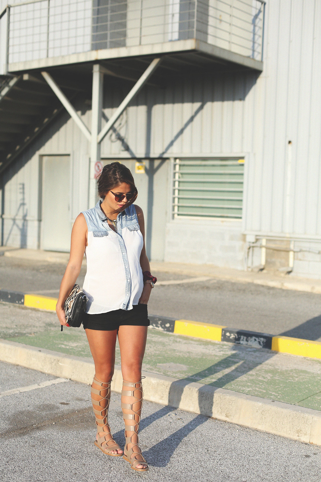 10. white denim vest black shorts sandals