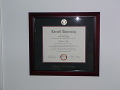 commemorative plaque(0.0), brand(0.0), picture frame(1.0), academic certificate(1.0), diploma(1.0),