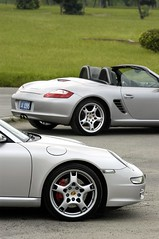 porsche carrera gt(0.0), automobile(1.0), automotive exterior(1.0), wheel(1.0), vehicle(1.0), performance car(1.0), automotive design(1.0), porsche boxster(1.0), porsche(1.0), rim(1.0), bumper(1.0), land vehicle(1.0), luxury vehicle(1.0), coupã©(1.0), convertible(1.0), supercar(1.0), sports car(1.0),