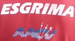flag(0.0), jersey(0.0), sportswear(0.0), t-shirt(0.0), advertising(0.0), text(1.0), trademark(1.0), font(1.0),