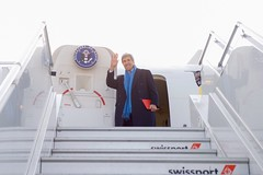 U.S. Secretary of State John Kerry waves goodbye at EuroAirport Basel Mulhouse Freiburg in Basel, Switzerland, before boarding his U.S. Air Force plane on January 18, 2017, for the last flight of his tenure as a Cabinet officer after attending the World Economic Forum in Davos, Switzerland. [State Department photo/ Public Domain]