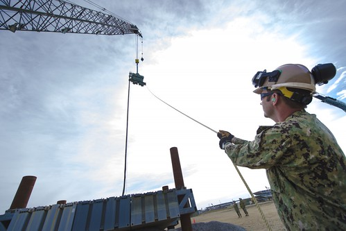 Amphib Seabees Pound Piles, Build Causeway