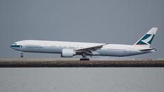 Cathay Pacific Boeing 777 -300 B-KQX landing at SFO, port profile, tire smoke DSC_0833