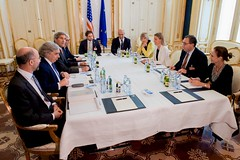 U.S. Secretary of State John Kerry - flanked by National Security Council Senior Director for Iran, Iraq, Syria and the Gulf States Robert Malley, U.S. Energy Secretary Dr. Ernest Moniz, Under Secretary of State for Political Affairs Wendy Sherman, and State Department Chief of Staff Jon Finer - sits across from European Union High Representative for Foreign Affairs Federica Mogherini and other advisers on June 28, 2015, in Vienna, Austria, before they exchange notes about ongoing negotiations over the future of Iran's nuclear program. [State Department Photo/Public Domain]