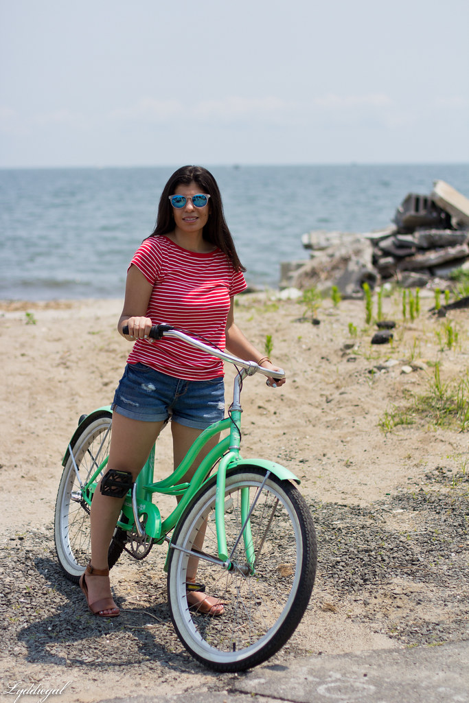 striped tee, denim shorts, riding on a beach cruiser bike-1.jpg