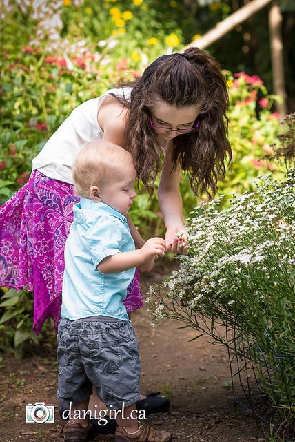 outdoor portrait of children in the flower garden