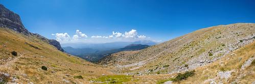 tymphi panorama greece greek landscape scenery view green blue sky clouds cloud summer lighting shadow rock rocks forest ledge mountain outdoor ridge mountainside hill