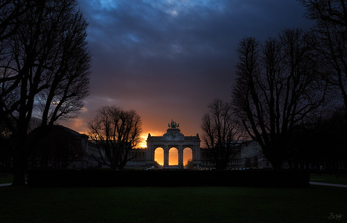 anniversary arches brussels clouds colors early fiftieth landscape morning park sun sunrise