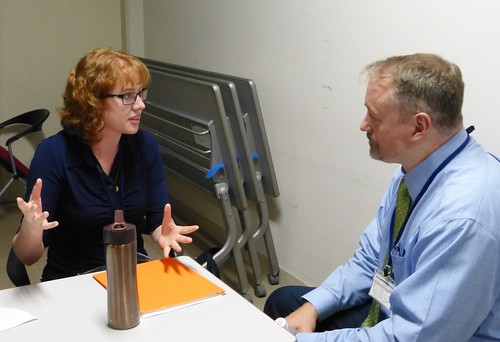 Caitlin Smith, a graduate student at Notre Dame, explains Clarel to Tony McGowan, our Executive Director.