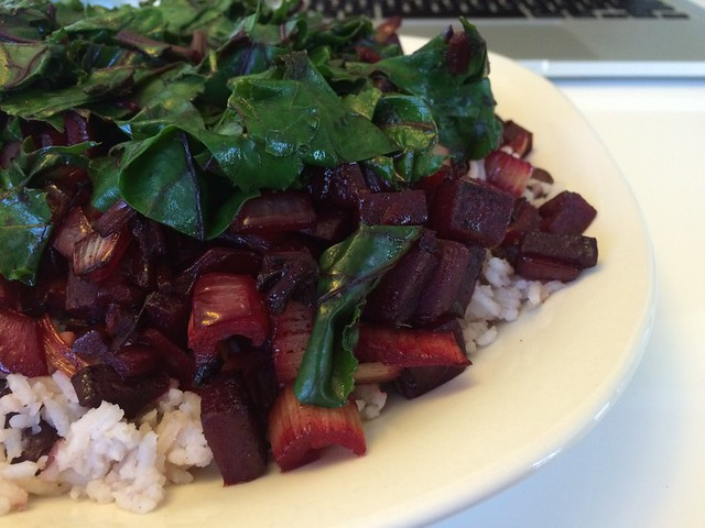 Beet hash with beet greens over Jamaican coconut rice and beans.