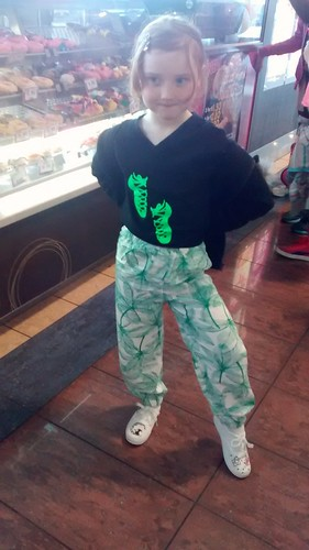 """Iron Craft - I forgot to photograph my Craft for this challenge before going out of town, so here is my daughter modelling her """"dreaming of spring"""" (southern hemisphere)/""""something green"""" new pants at the airport grabbing a donut before catching our plane"""