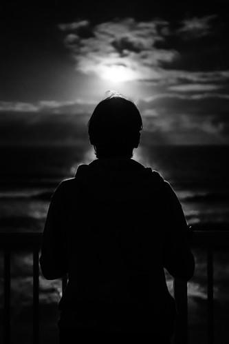 view looking tranquil calm woman black moon white blackandwhite light sea indialantic florida unitedstates us onsale faceless