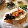Sausage grill sandwich at Bar Ochel, Carmel Market, Tel Aviv.