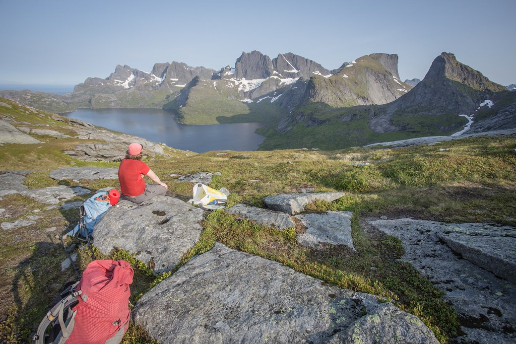 Rest after a 400m steep climb up. Solbjornvatnet down below. Lofoten archipelago. Norway. #6monthspregnantinpicture