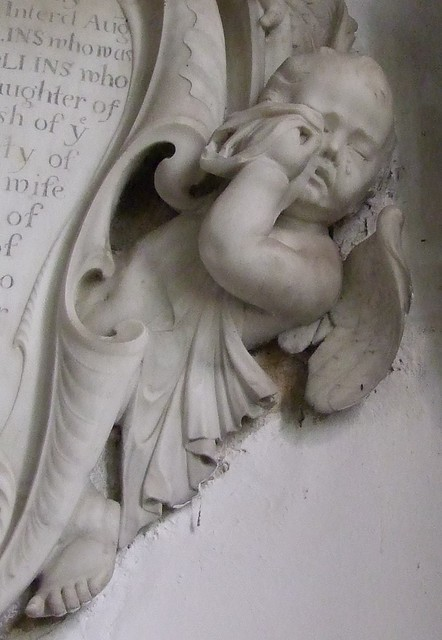 Brightling, Sussex, St Thomas a Becket, weeping putti