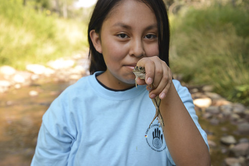 Native American youth connecting with the environment.