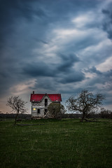 Night falling over Abandoned House