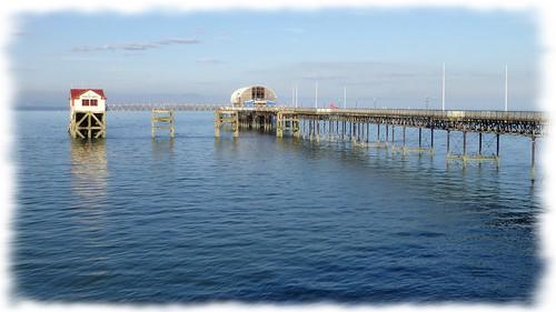 sea seascape building water architecture landscape coast pier serene mumbles tranquil