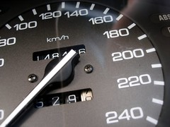 automotive exterior(0.0), wheel(0.0), rim(0.0), steering wheel(0.0), tachometer(0.0), odometer(1.0), vehicle(1.0), gauge(1.0), font(1.0), speedometer(1.0),