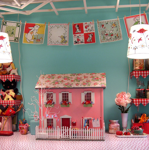 The dollhouse on the work table